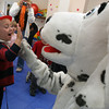 Essex: Charlie Swanson gives Sparky a high-five following a fire safety program at Lil' Sprouts of Essex yesterday morning. Manchester and Essex firefighters visited the school as part of Fire Prevention Week. Photo by Kate Glass/Gloucester Daily Times
