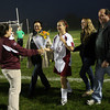 Gloucester: Coach Alex White hands a bouquet of flowers to senior captain Stephanie Kelley as she and her family are honored during senior night before the Gloucester's game against Lynn English at Newell Stadium last night. Photo by Kate Glass/Gloucester Daily Times
