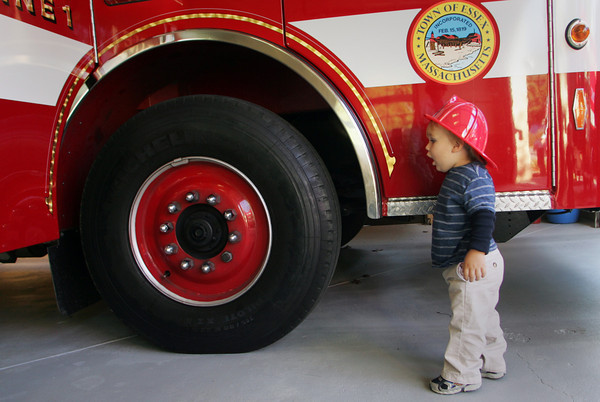 Essex: Max Fritsch, 18 months, looks at how big the tires are on a fire truck at the Essex Fire Station Thursday afternoon. The Essex Fire Department held an open house for Fire Prevention Week letting kids check out all the truck and enjoy some pizza. Mary Muckenhoupt/Gloucester Daily Times