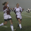 Gloucester: Gloucester's Elle Wierbicky, right, and Lynn English's Shannon Kidney chase after the ball during their game at Newell Stadium last night. Photo by Kate Glass/Gloucester Daily Times