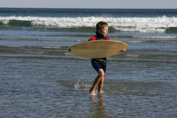 Gloucester:  Tyler Nobile, 7, runs with his skimboard looking for a perfect spot to glide across the water while enjoying the nice weather at Good Harbor Beach Saturday afternoon.  Mary Muckenhoupt/Gloucester Daily Times