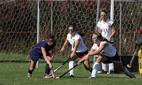 Gloucester's ____ Legendre (12) and Julia Lamouneux (22) reach foward and try to steal the ball from Peabody's Callie Soumas, left, during their game on Monday morning as Jill MacDonald looks on. David Le/Gloucester Daily Times