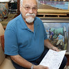 Captain Phil Cusumano, holds plans for a proposed Breakwater Marina which would sit in Gloucester Harbor and would offer an additional 30 transient boating spots. David Le/Gloucester Daily Times