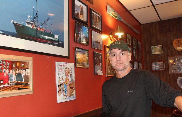 Gregg Sousa, owner of the Crow's Nest, stands inext to a photo of the Andrea Gail 20 years after in went down in what's now refered to as the Perfect Storm. Jesse Poole/Gloucester Daily Times Oct. 27, 2011