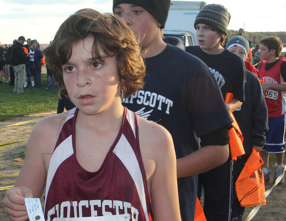 Gloucester's Kory Hurd, 6th grade, waits in the finish line after completing the boys Northeast Conferance race at the Jim Munn Invitational at Stage Fort Park on Friday afternoon. Jesse Poole/Gloucester Daily Times Oct. 28, 2011