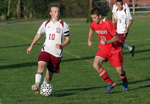Rockport junior captain Conor Douglass carries the ball upfield while being pressured by an Amesbury defender. David Le/Gloucester Daily Times