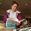 Carrie DeFort, of Rockport, looks through some children's books at Rockport Public Library's Book Sale on Friday morning. David Le/Gloucester Daily Times