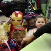 Children of Sandy Bay Preschool crowd into Butler's Haberdashery as David Butler, owner of the store, hands out Halloween candy to Iron Man, Snow White and a few other princesses. Jesse Poole/Gloucester Daily Times Oct. 31, 2011
