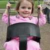 Rose Warner, 3, of Magnolia smiles as she swings along at Masconomo Park on Tuesday afternoon. David Le/Gloucester Daily Times