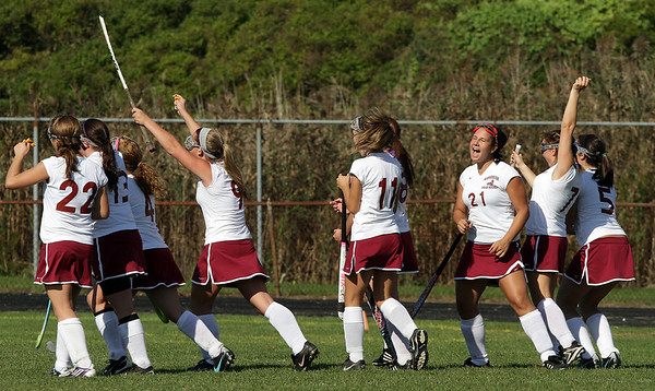 Andie Jane Phinney (21) and the rest of her teammates react after Erica Morse (not pictured) scored the first goal of the game against Peabody on Monday morning at Newell Stadium. David Le/Gloucester Daily Times