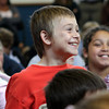 East Gloucester Elementary 4th grader Patrick Broe, laughs at a joke by Geography Game Show host Neal Nichols. David Le/Gloucester Daily Times