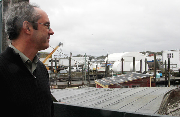 Tom Balf, new executive directer of Maritime Gloucester, looks out over Gloucester Harbor from outside the Maritime Gloucester museum. Jesse Poole/Gloucester Daily Times Oct. 27, 2011