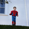 Robbie Morris, 3, dressed as Spiderman, stands tall after collecting a significant amount of candy with the Sandy Bay Preschool as its children visited various downtown businesses on Monday morning. Jesse Poole/Gloucester Daily Times Oct. 31, 2011