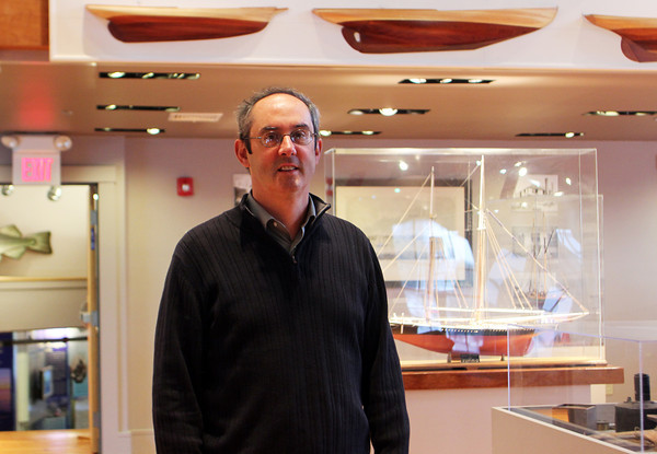 Tom Balf, new executive directer of Maritime Gloucester, stands amongst the exhibitions at the museum. Jesse Poole/Gloucester Daily Times Oct. 27, 2011