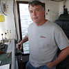 Captain Stephen Welch, of the Holly and Abby, stands at the helm of his fishing boat as they docked at Marine Railways for servicing. David Le/Gloucester Daily Times