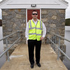 "Mike Hale, Director of Public Works in Gloucester stands in front of the Babson Reservoir Dam. The City of Gloucester is trying to fix the dam, deemed by Hale as the ""most hazardous"" of the 4 dams in need of repair. David Le/Gloucester Daily Times"