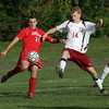 Rockport's Matt Rostowski (14), battles for a 50/50 ball with an Amesbury player. David Le/Gloucester Daily Times