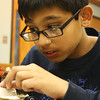 Ammar Syed, 11, of Gloucester, focuses on building a Halloween themed craft at Lego Club on Monday afternoon at the Sawyer Free Library in Gloucester. Jesse Poole/Gloucester Daily Times
