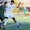 Sean Gutierrez, midfielder for Manchester Essex Regional High School, dribbles past a North Reading High School midfielder, Max Carlson on Tuesday afternoon. Jesse Poole/Gloucester Daily Times
