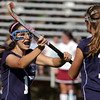 Peabody's Sabrina Rizzo, left, celebrates with teammate Noelle Koch, right, after Rizzo scored a goal to bring Peabody even with Gloucester at 1-1. David Le/Salem News