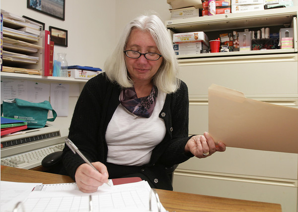 Arlene Lesch, the Probation Case Coordinator at Gloucester District Court, works on some paperwork on Tuesday afternoon. David Le/Gloucester Daily Times