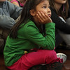 East Gloucester Elementary 3rd grader Rizza Anderson watches as Neal Nichols draws a map of the United States during his Geography Game Show on Friday morning. David Le/Gloucester Daily Times
