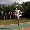 Keppler McClelland, 19, of Essex, plays basketball at Centennial Grove Park on Wednesday afternoon. David Le/Gloucester Daily Times