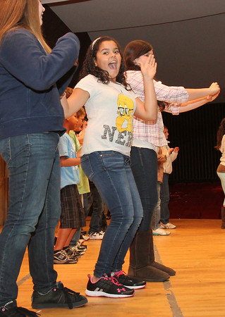 "O'Maley Middle School 6th grader Anais Montesino, center, dances along with her classmates to ""Stereo Hearts"" by Gym Class Heroes and Adam Levine following a presentation of speeches on their strengths and weakenesses as part of the school's S.A.I.L.S. program. David Le/Gloucester Daily Times"