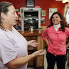 Councilor-at-Large, Mary Ellen Rose, right, talks with Patty Philbrick, owner of the Two Sisters Coffee Shop on Washington St. during her campaign. David Le/Gloucester Daily Times