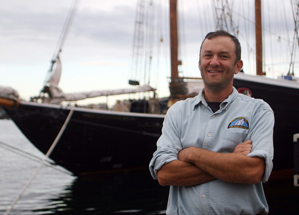 Ben Hale, Captain of The Highlander, stands in front of his schooner which is currently docked at Gloucester Marine Railways in Rocky Neck, Jesse Poole/Gloucester Daily Times