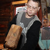 Joey Dusablon, 9, a student at Veterans School in Saugus, makes a wooden peg by hammering a square block of wood through a circular mold during an annual field trip to the Essex Shipbuilding Museum. David Le/Gloucester Daily Times