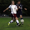Rockport junior Caden Tibert, left, battles for the ball with Hamilton-Wenham's Nick Fusco, right during their game on Wednesday night. David Le/Gloucester Daily Times