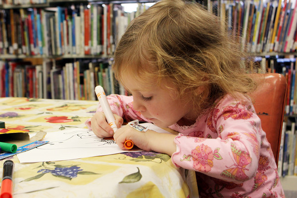 Ella Benedetto, 4, of Marblehead, colors at the Rockport Public Library after the Preschool Story Hour. Jesse Poole/Gloucester Daily Times Oct. 25, 2011