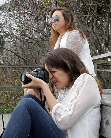 Twin sisters Amanda, front, and Taryn Johnson, of Manchester, and senior communication majors at Elon University, film a movie at Singing Beach.  David Le/Gloucester Daily Times