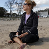 Marcia Polese, of Manchester, enjoys a warm October afternoon sitting on Singing Beach and listening to music. David Le/Gloucester Daily Times