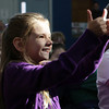East Gloucester 3rd grader Tessa Bushfield gives a thumbs up to Geography Game Show host Neal Nichols on Friday morning during an examination of the 50 states. David Le/Gloucester Daily Times