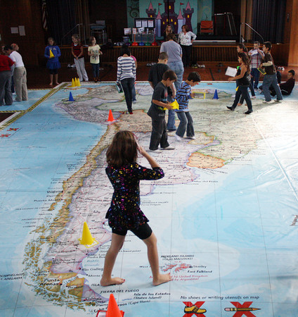 Beeman Elementary students explore a map of South America on the floor of their gymnasium on Friday afternoon. Jesse Poole/Gloucester Daily Times
