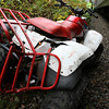 A damaged ATV driven by Gloucester resident Robert Hovis, lies on the side of the train tracks just past the overpass on Route 128 near Blackburn Circle. Hovis was riding along the tracks and was forced to drive up and steep embankment and leap off the ATV to avoid being seriously injured. David Le/Gloucester Daily Times