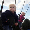 Madelyn Jay, left, and her twin sister Kathleen, 2, enjoy swinging at Shepard Memorial Park in Essex Tuesday mornng. Jesse Poole/Gloucester Daily Times. October 25, 2011