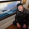 "Peter ""Spike"" Wademan, an artist from New Zealand and who recently moved to Gloucester, kneels next to his painting of the _________. David Le/Gloucester Daily Times"