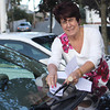Ann Mulcahey, incumbent Ward 2 councilor, places a re-election campaign pamphlet on a car parked near Green Street. Jesse Poole/Gloucester Daily Times