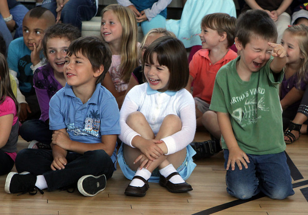 "Rockport Elementary students from left, Dimitri Cosentino, Anna Drost,a nd Kevin Lahey laugh at a joke told by ""Gary the Space Guy"" during his skit called ""Reach for the Stars."" David Le/Gloucester Daily Times"