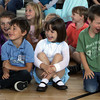 """Rockport Elementary students from left, Dimitri Cosentino, Anna Drost,a nd Kevin Lahey laugh at a joke told by """"Gary the Space Guy"""" during his skit called """"Reach for the Stars."""" David Le/Gloucester Daily Times"""