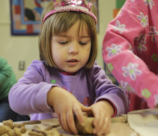 Lila Proposki, 4, of Rockport, begins to sculpt a turkey out of clay at Rainbow Day School on Wednesday morning. Jesse Poole/Gloucester Daily Times October 26, 2011