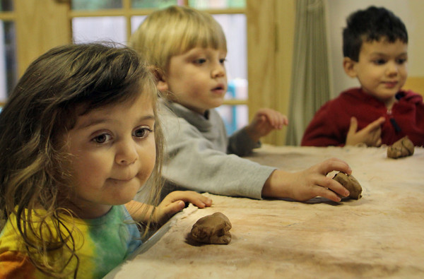 Mari Penaloza, 3, of Rockport, waits for instructions before starting to make clay turkeys with her Rainbow Day School friends Wednesday morning. Jesse Poole/Gloucester Daily Times October 26, 2011