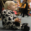 Roy Turner, 1, of Gloucester, wears a cow costume to Story Time at the Sawyer Free Library on Thursday morning. Jesse Poole/Gloucester Daily Times Oct. 26, 2011
