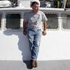 Captain of the Holly and Abby, Stephen Welch relaxes on the front of his boat as it was docked in Marine Railways for servicing. David Le/Gloucester Daily Times