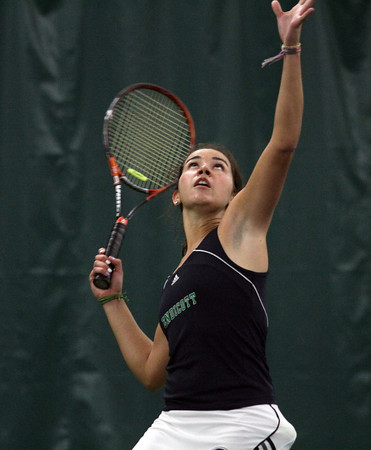 Endicott College freshman Natalie Egbert follows the ball as she serves to a Roger Williams opponent during the semi-final of the CCC Tournament at Manchester Athletic Club. David Le/Gloucester Daily Times
