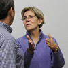 Harvard Professor and US Democratic Senate Candidate Elizabeth Warren talks with the owner of Intershell Seafood, Monty Rome on Thursday afternoon on a visit to Gloucester. David Le/Gloucester Daily Times