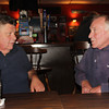 Richard Haworth, left, former captain of the Andrea Gail (from 1978 to 1986), chats with Jack Flaherty, a Gloucester fisherman, at the Crow's Nest Wednesday evening. Each men have theories as to how the Andrea Gail was lost at sea 20 years ago. Jesse Poole/Gloucester Daily Times Oct. 25, 2011